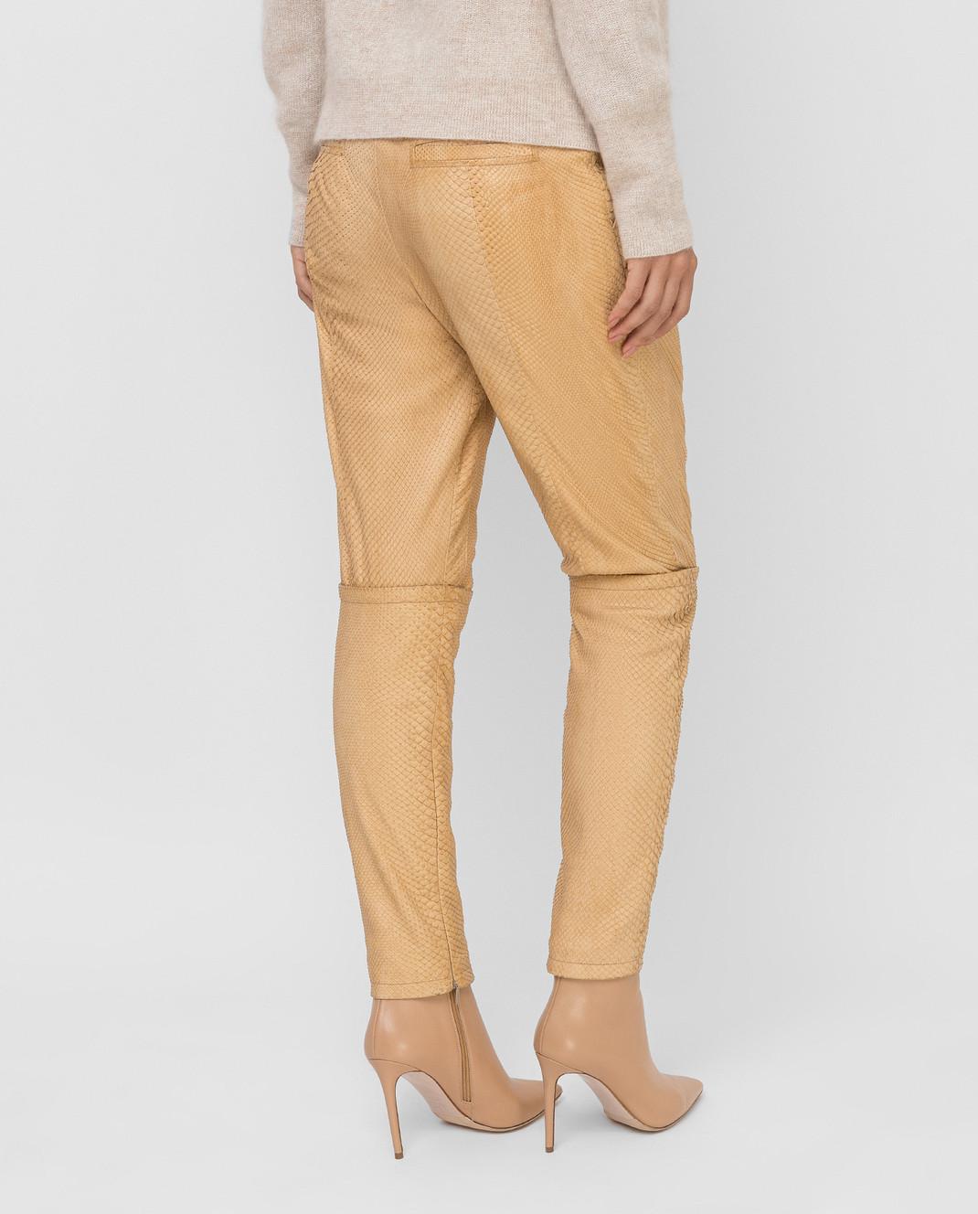 Gucci Бежевые брюки из кожи питона 264366 изображение 4