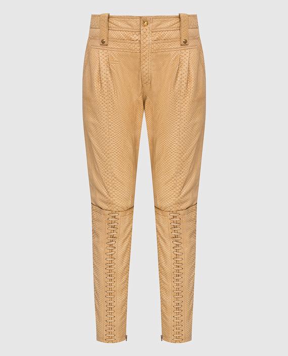 Бежевые брюки из кожи питона