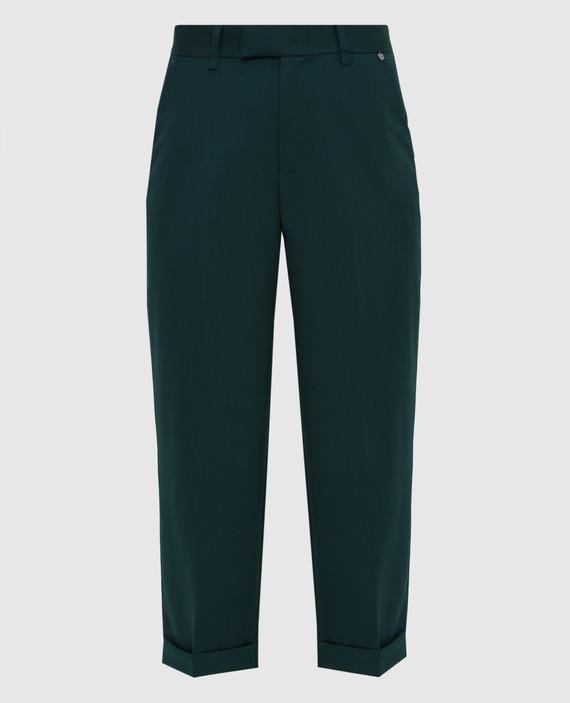 Темно-зеленые брюки
