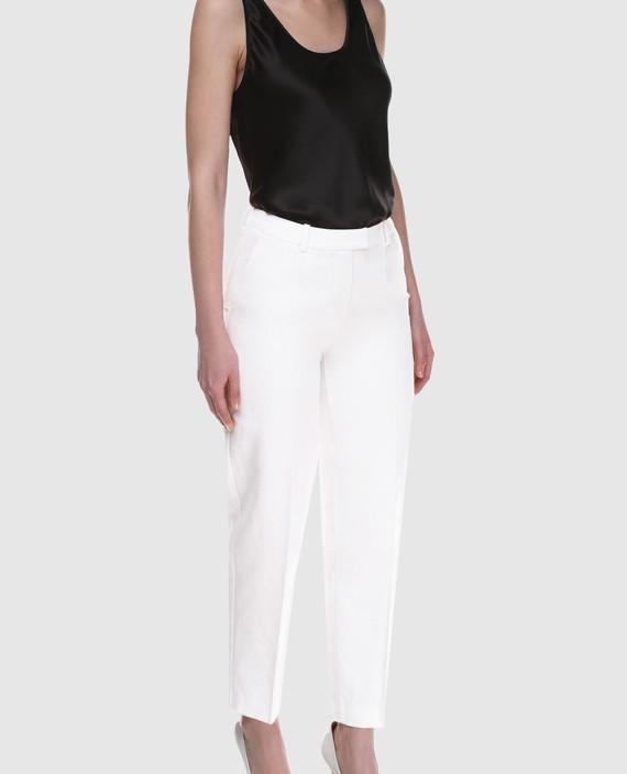 Белые брюки hover