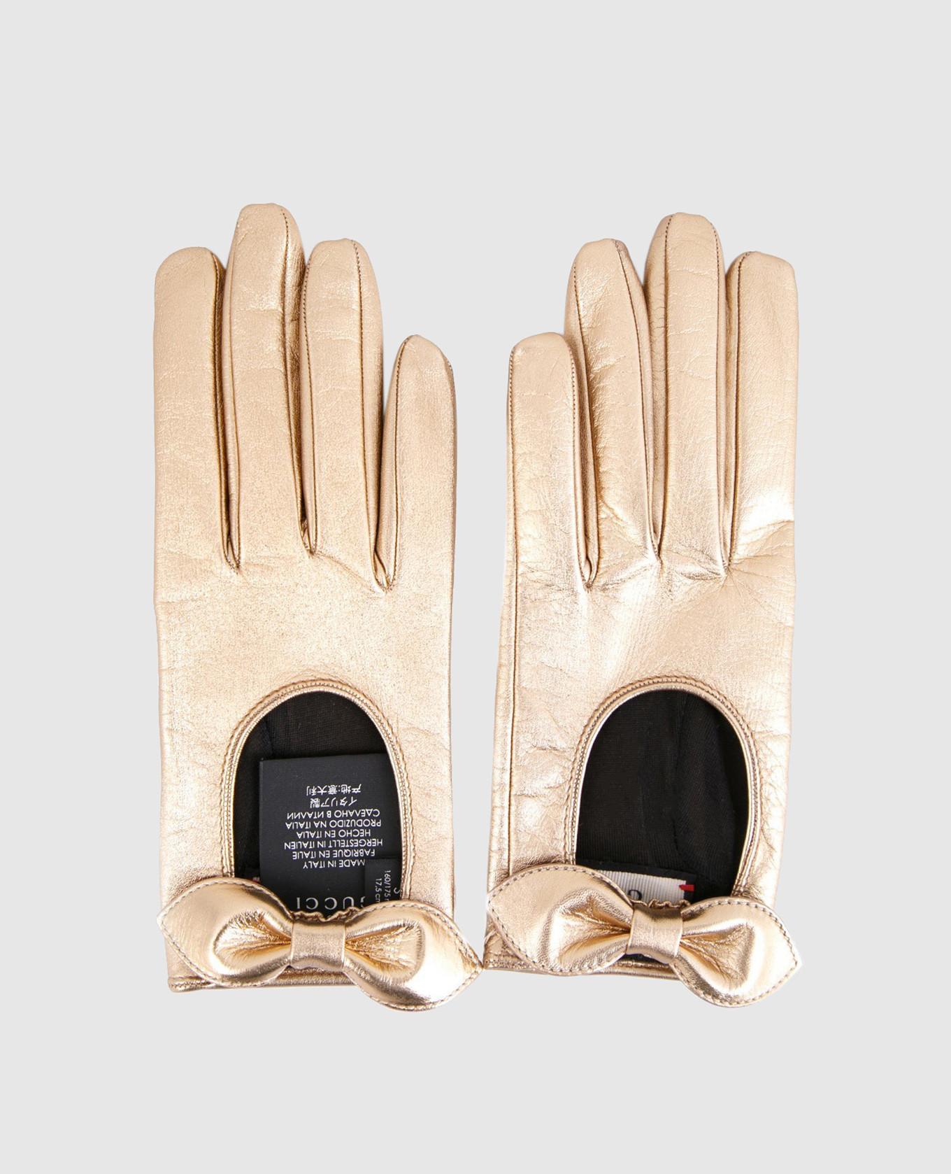 Золотистые кожаные перчатки с бантами