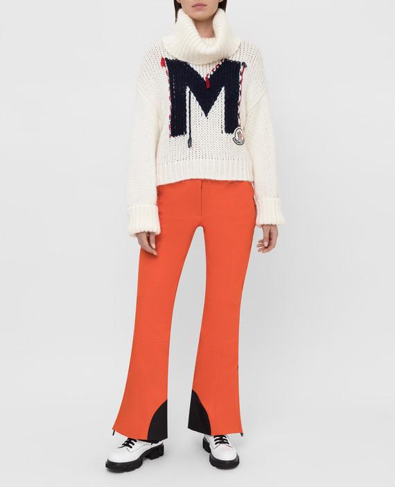 Оранжевые лыжные брюки hover