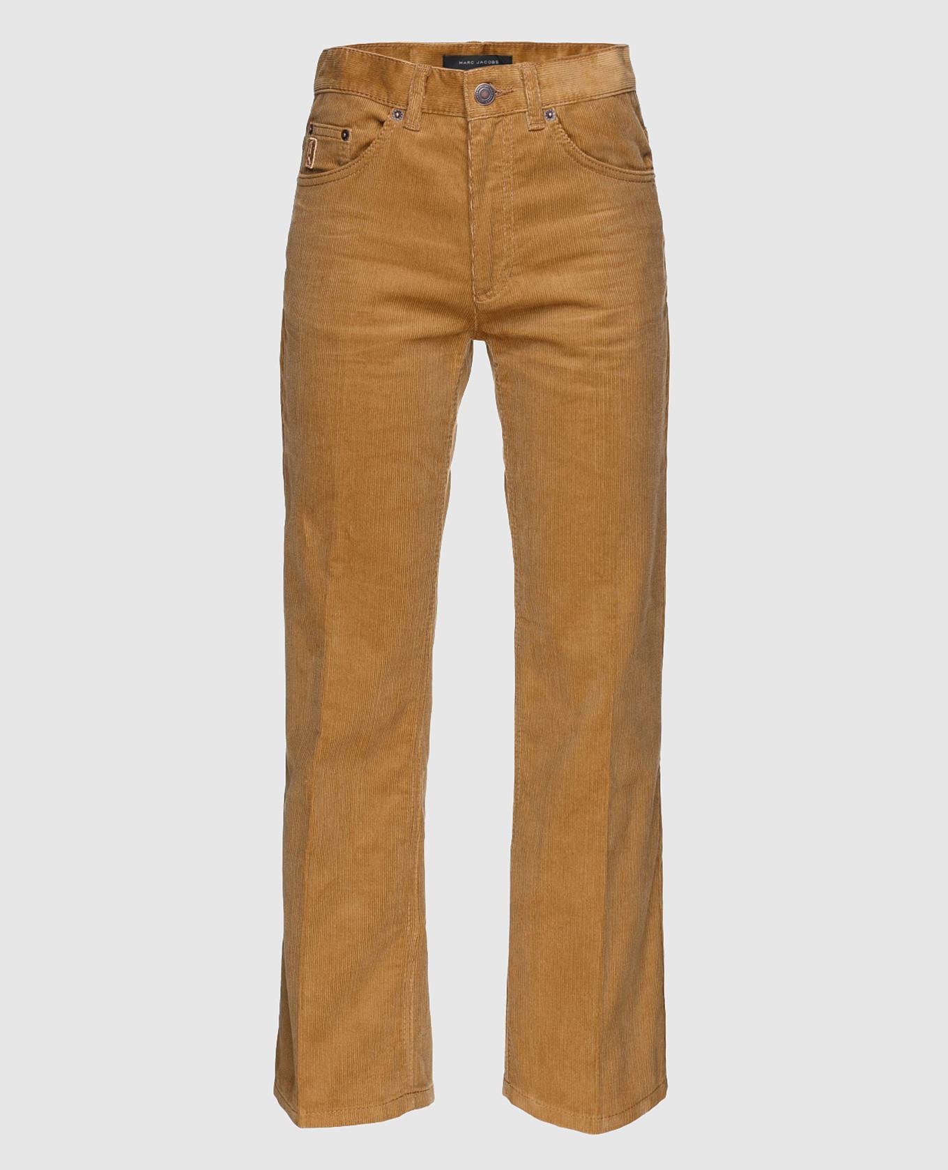Рыжие вельветовые брюки