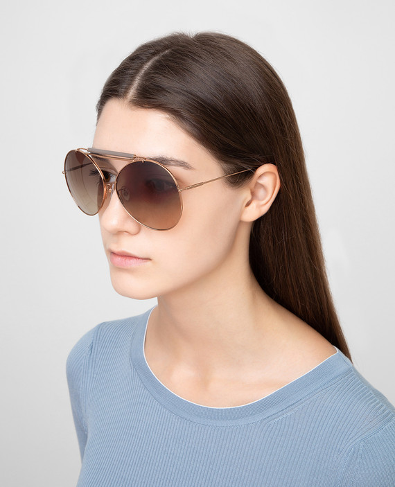 Золотистые солнцезащитные очки hover