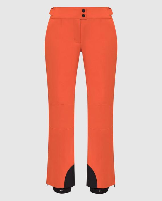 Оранжевые лыжные брюки