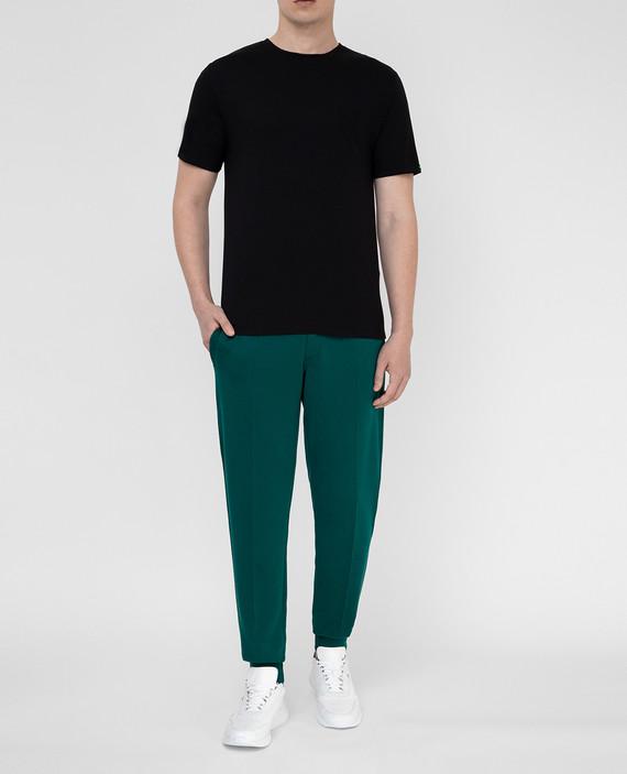 Зеленые спортивные брюки hover