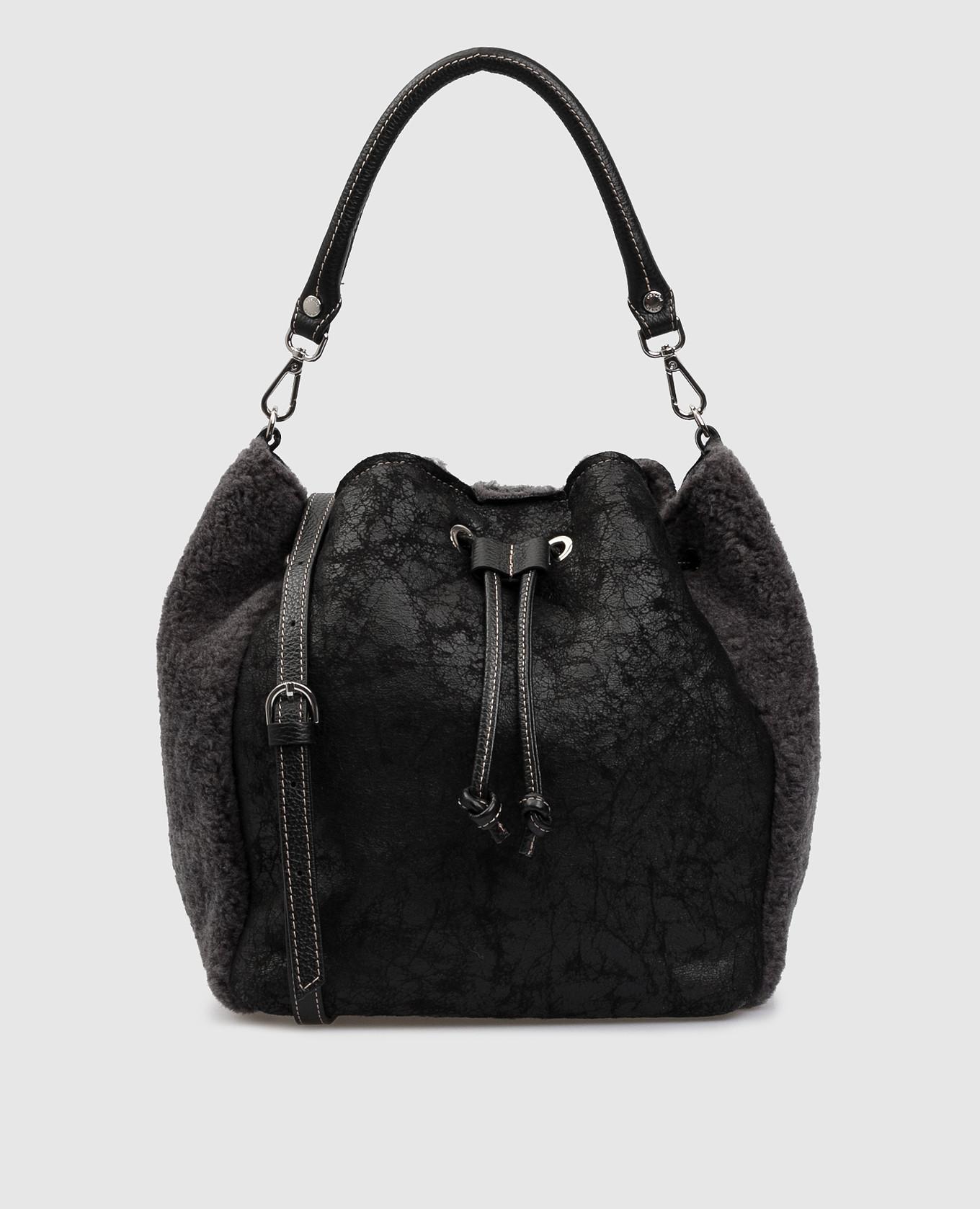 Черная сумка из кожи и меха