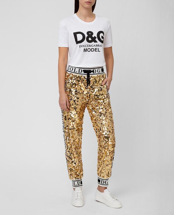 Золотистые брюки hover